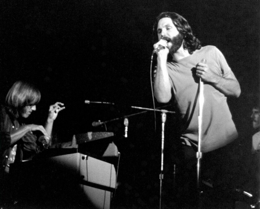 The Doors' Ray Manzarek (left), Jim Morrison and John Densmore perform at the San Diego Sports Arena on August 22, 1970.