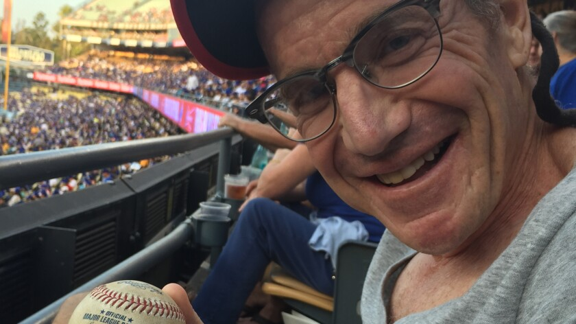 Dr. Michael Levi with foul ball he caught and gifted to new friends.