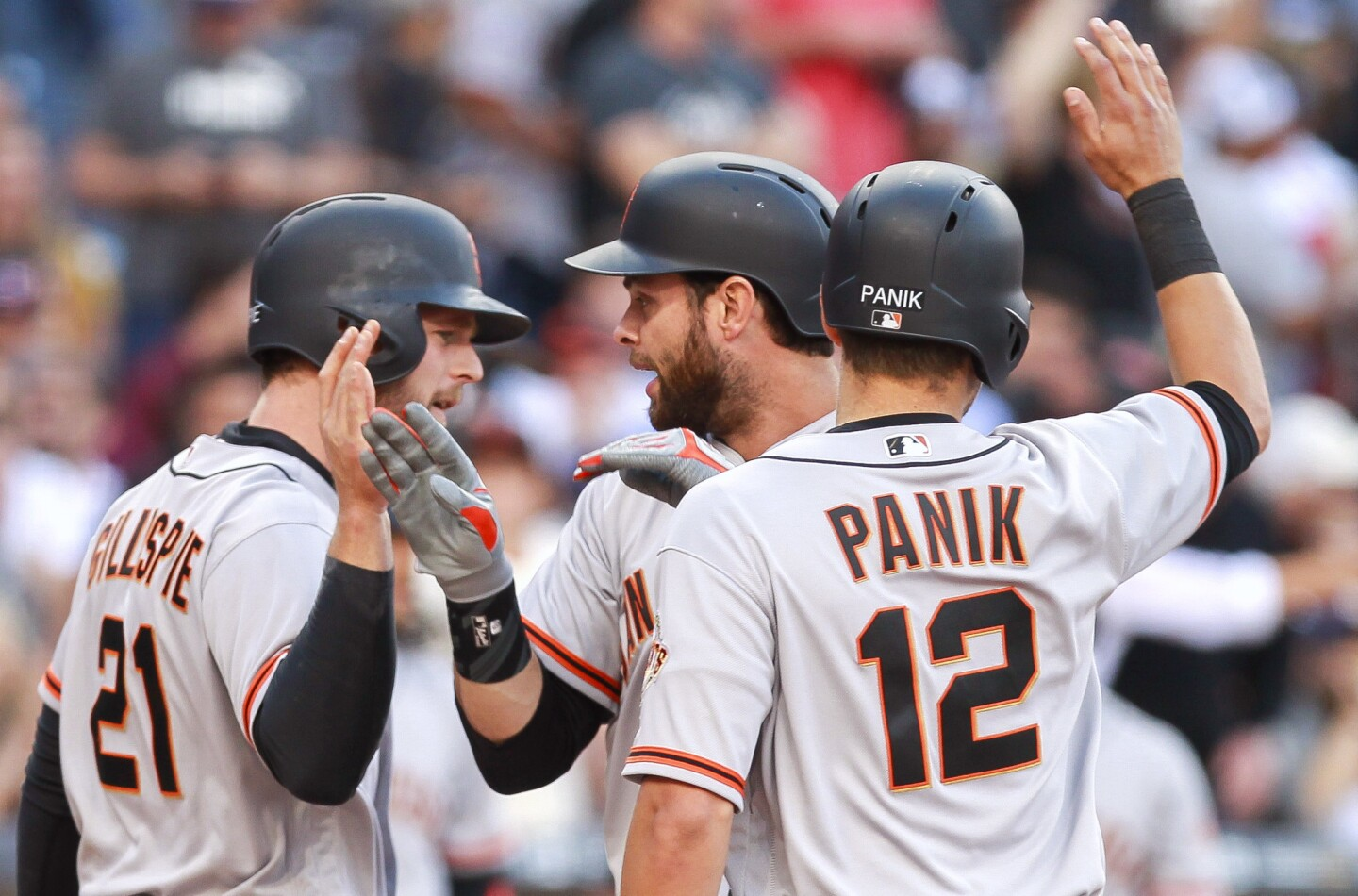 SAN DIEGO, April 7, 2017 | The Giants' Brandon Belt, center, celebrates with Conor Gillaspie, left, and Joe Panik after Belt hit a grand slam in the sixth inning during the Padres home opener at Petco Park in San Diego on Friday. | Photo by Hayne Palmour IV/San Diego Union-Tribune/Mandatory Credit: HAYNE PALMOUR IV/SAN DIEGO UNION-TRIBUNE/ZUMA PRESS San Diego Union-Tribune Photo by Hayne Palmour IV copyright 2016
