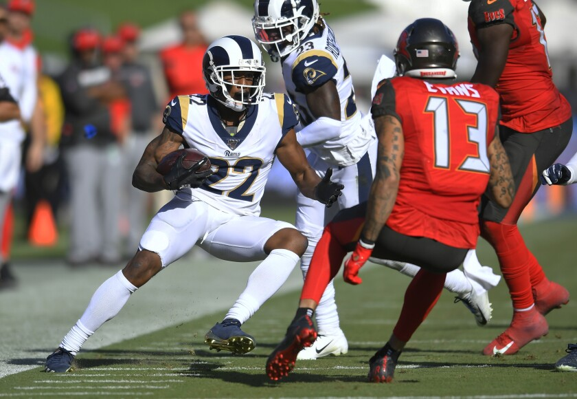 The Rams' Marcus Peters returns an interception for a touchdown against the Buccaneers.