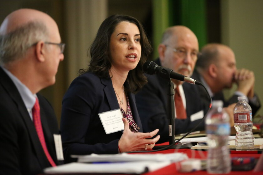 Sarah Angel, a regional director for the California Charter Schools Assn., praises charters at a recent forum on the future of Los Angeles public education. A new group is trying to launch more of these schools.