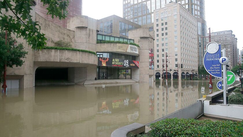 Flooding in Houston's Theater District caused by tropical storm Harvey. As Houston's cultural institutions assess the damage, some have temporarily closed or cancelled performances.