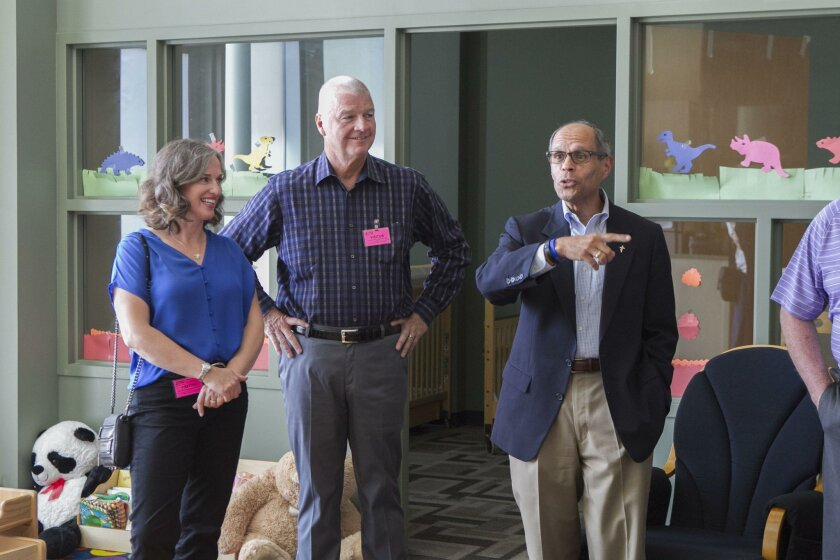 Pat and Stephanie Kilkenny, left, listen to Deacon Jim Vargas of Father Joe'ss Village during a tour of the facility on Aug. 26.