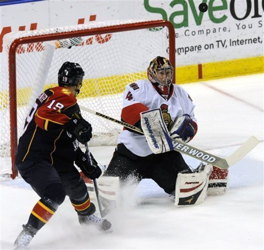 Florida Panthers' Marty Reasoner, left, watches the puck deflect off Ottawa Senators goalie Craig Anderson during the first period of an NHL hockey game on Thursday, March 31, 2011, in Sunrise, Fla. (AP Photo/Rick Silva)