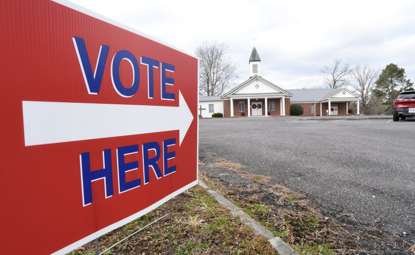 A sign at the street points voters to a polling place at Dawnville United Methodist Church in Dawnville, Ga., on Tuesday, Jan. 5, 2021. (Matt Hamilton/Chattanooga Times Free Press via AP)