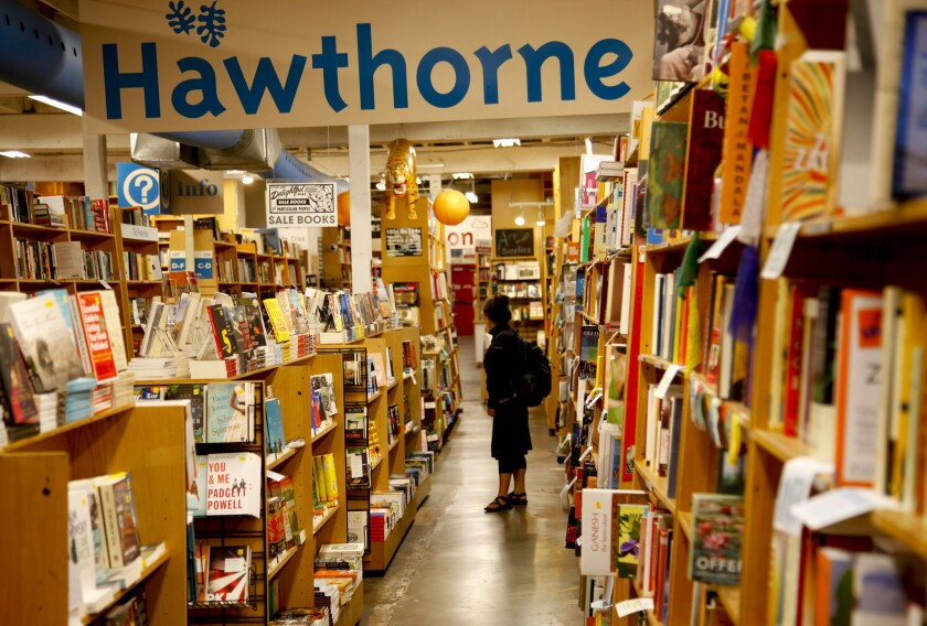 A customer browses the shelves at Powell's Books in 2013.