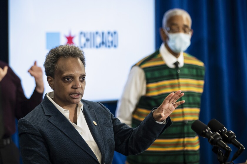 "U.S. Rep. Bobby Rush looks on as Mayor Lori Lightfoot speaks during a news conference in Chicago on Thursday afternoon, June 11, 2020, about a group of Chicago police officers in the congressman's campaign office while looters hit nearby stores. More than a dozen officers and supervisors from the Chicago Police were captured on video ""lounging"" inside a congressional campaign office on the city's South Side as people vandalized and stole from nearby businesses while protests and unrest spread across the city in late May, Mayor Lori Lightfoot said Thursday. (Ashlee Rezin Garcia/Chicago Sun-Times via AP)"