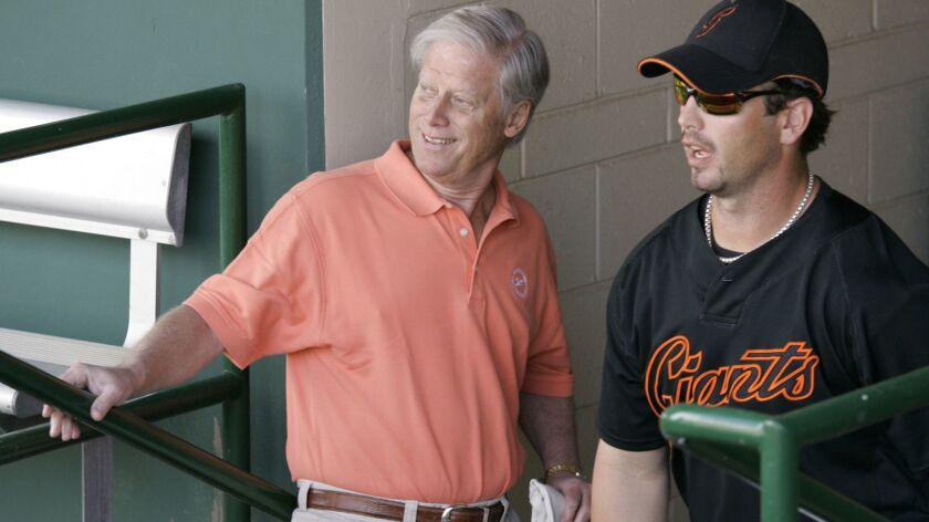San Francisco Giants Managing General Partner Peter Magowan, left, visiting with center fielder Aaron Rowand before a spring training game against the Oakland Athletics in 2008.