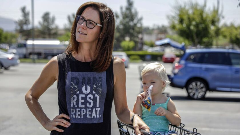 """Erin Griffin, with her daughter Julia, in Temecula. Griffin said that Hunter's indictment worried her but that she'd """"have a hard time supporting a Democrat."""""""