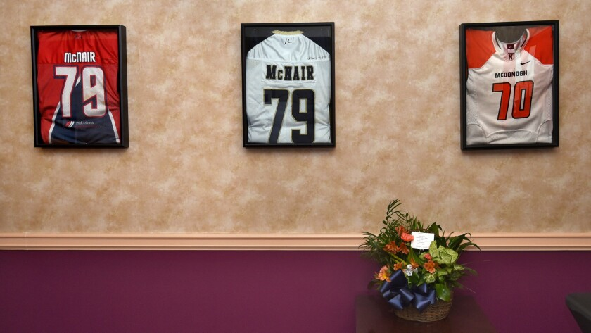 Framed jerseys were part of a viewing for deceased Maryland football player Jordan McNair.