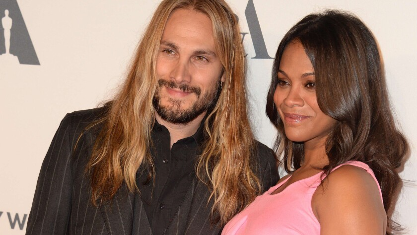 """Zoe Saldana and Marco Perego arrive at a reception to celebrate the Oct. 1, 2014, opening of the multimedia exhibition """"Hollywood Costume"""" in Los Angeles."""