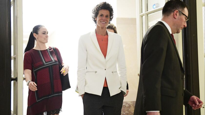 Andrea Constand, center, chief accuser in the Bill Cosby trial, returns from lunch during the sexual assault trial at the Montgomery County Courthouse.