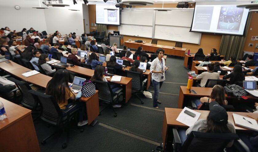 Dr. Dalia Salloum teaches a general education science class at Cal State San Marcos. The four-year graduation rate is below 20 percent at roughly half of the 23 campuses in the California State University system.