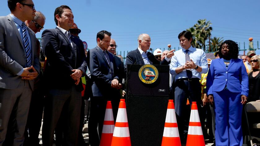 Anthony Rendon, Jerry Brown and Kevin de Leon