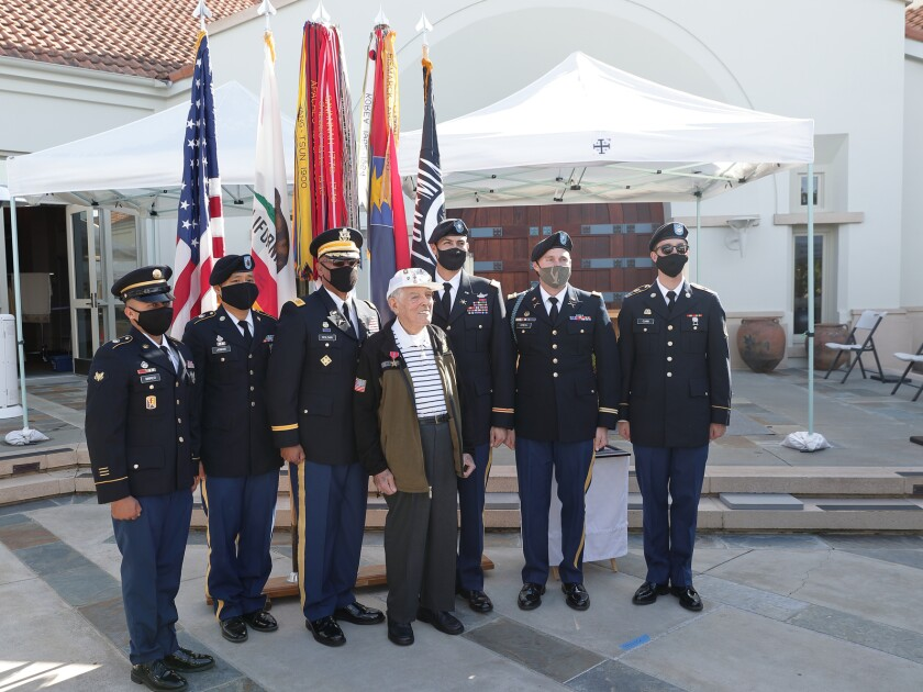 Representatives of the US Army 40th Infantry Division with Bronze Star honoree Bob Baker (center)