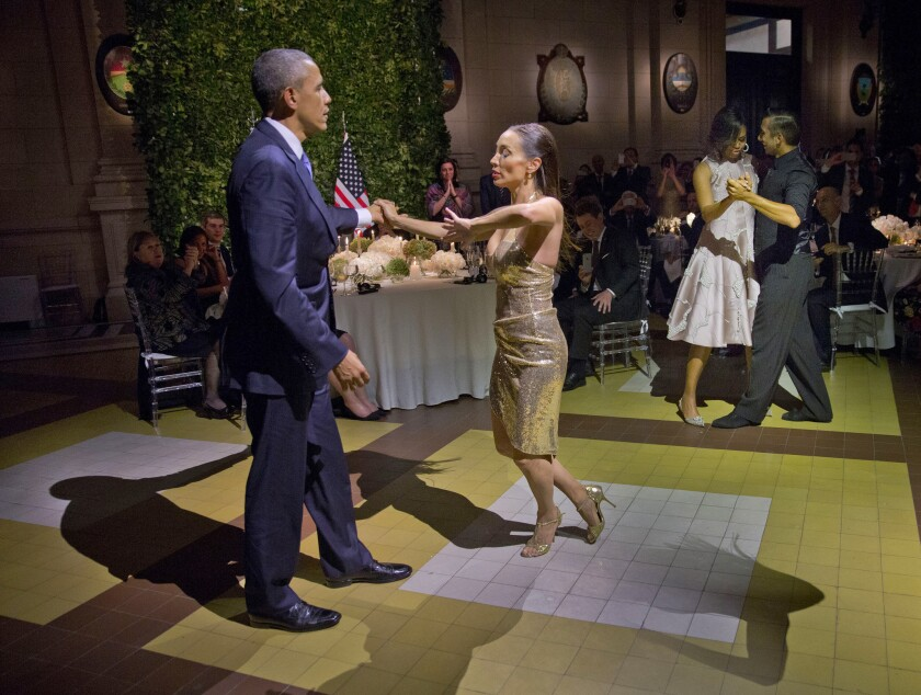 President Obama and First Lady Michelle Obama, at right, dance the tango at a state dinner in Buenos Aires.