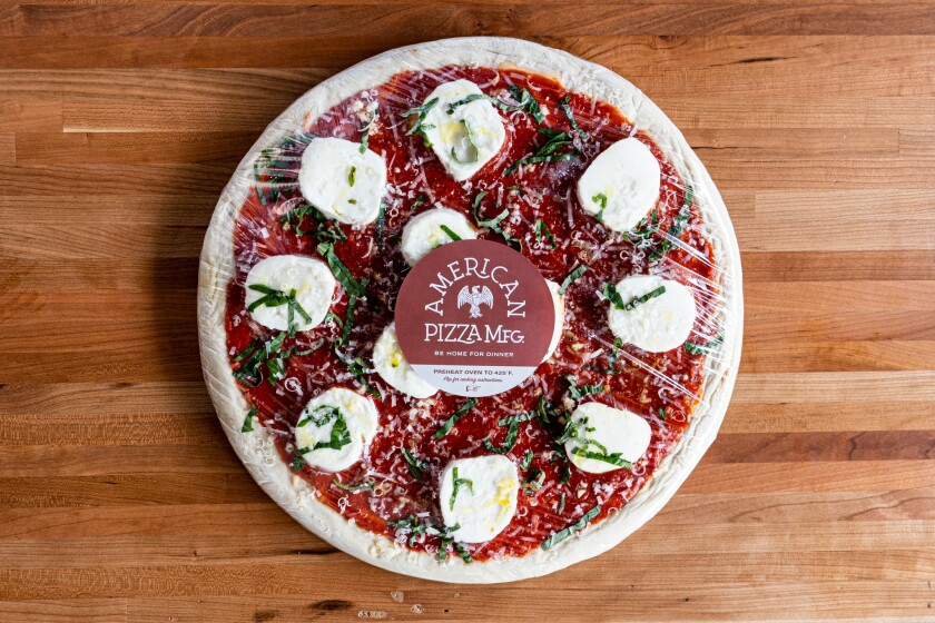American Pizza Mfg. at 7402 La Jolla Blvd. offers made-to-order take-and-bake pizza.