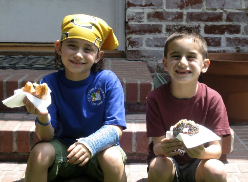 Jake Hofheimer, left, sits on the steps with younger brother Tommy for a photo in 2007, when he identified as a girl.