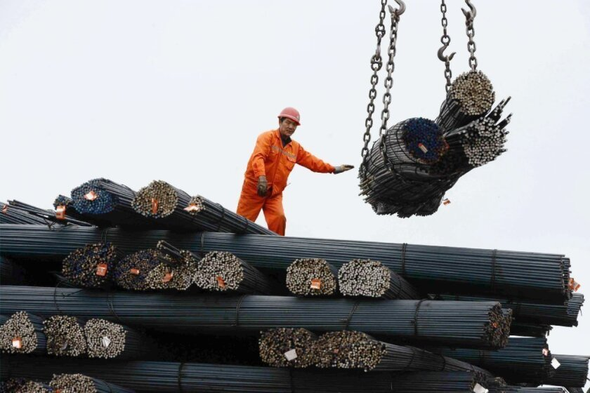 A laborer working in a steel factory in Qingdao, China.