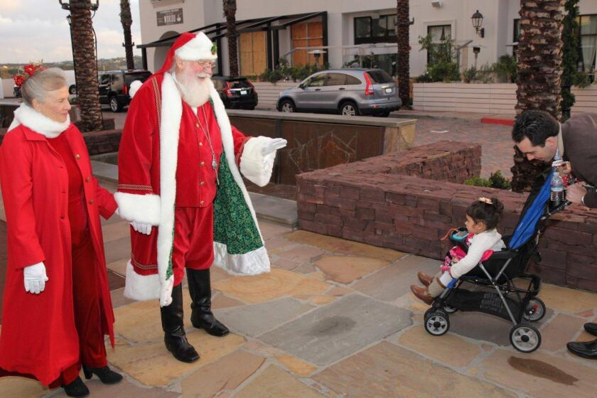 The McCarthy Family greets Santa and Mrs. Claus