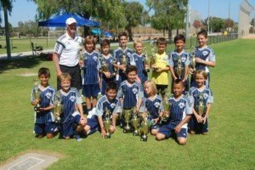 After battling through six matches in Flight 1 of the North Huntington Beach Soccer Tournament held over Labor Day Weekend, the DMCV Sharks BU11 team, coached by Warren Barton, came home as champions!