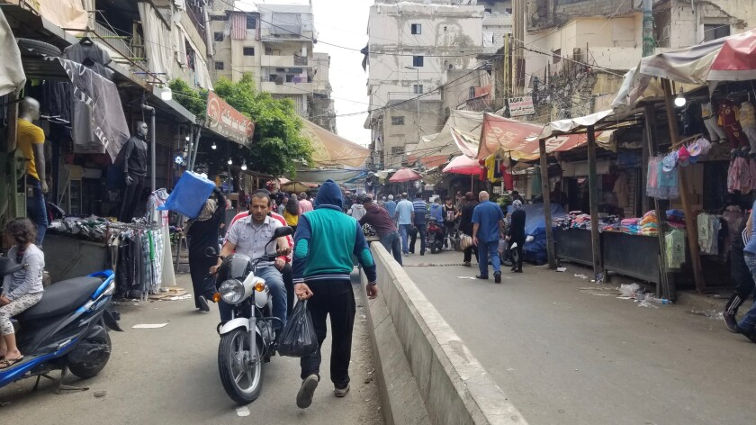 Sabra Street leads into Shatila, a decades-old camp for Palestinian refugees that has turned into a slum.