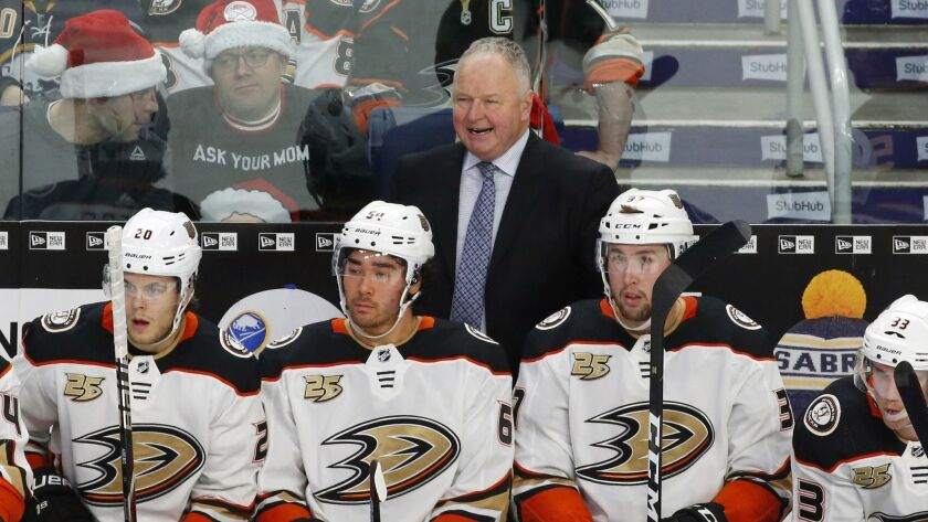 Anaheim Ducks head coach Randy Carlyle yells to players during the first period of an NHL hockey gam