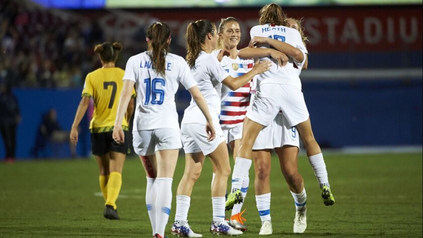 Tobin Heath (17) celebrates with U.S. teammates after scoring a goal against Jamaica during the first half of the CONCACAF Women's Championship semifinals.