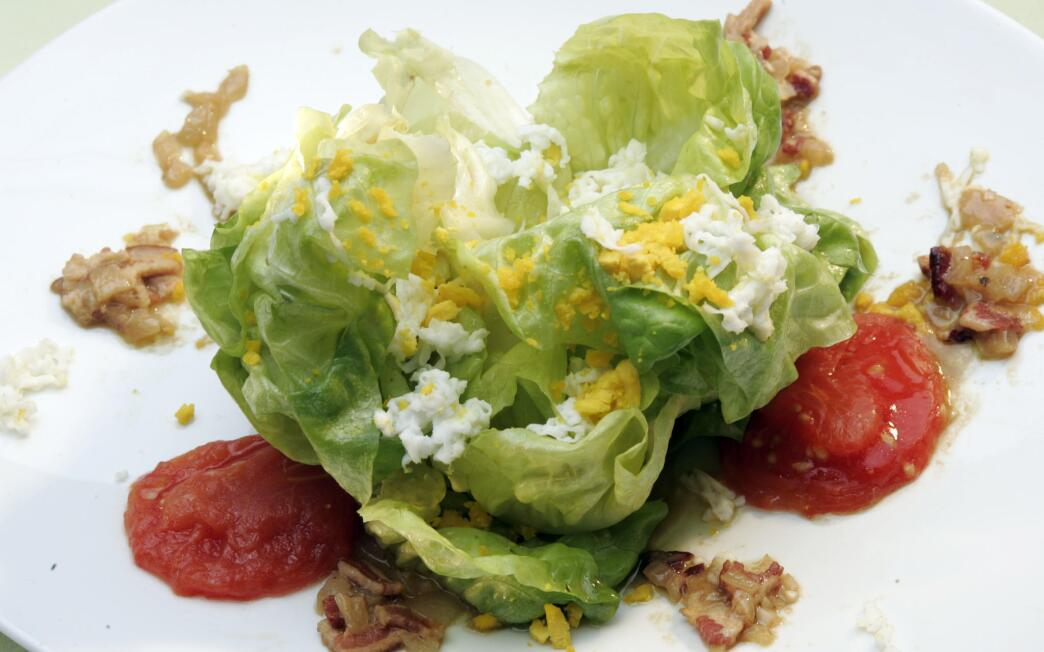 Butter lettuce salad with melted tomatoes and bacon-shallot vinaigrette