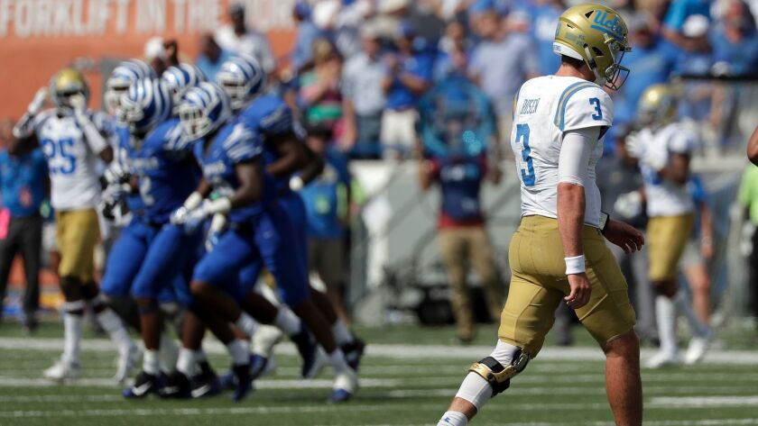 UCLA quarterback Josh Rosen leaves the field after throwing an interception against Memphis on Sept. 16.