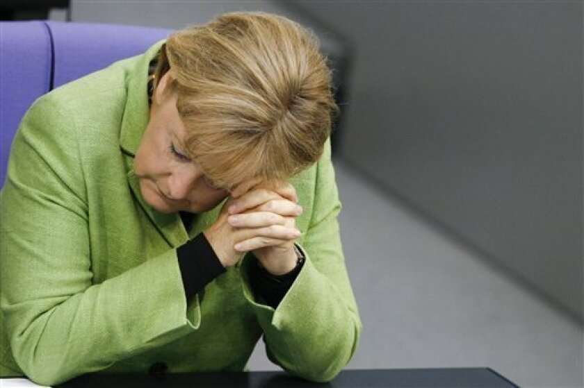 German Chancellor Angela Merkel listens during a debate about a law against tax evasion at the German parliament, the Bundestag in Berlin, Thursday, May 7, 2009. (AP Photo/Markus Schreiber)
