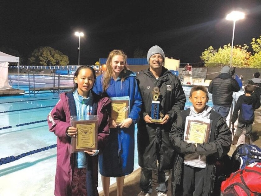 PAC Swim's Rachel Yang, Cami Collins and Jonathan Cong with Head Coach Pete Murphy.