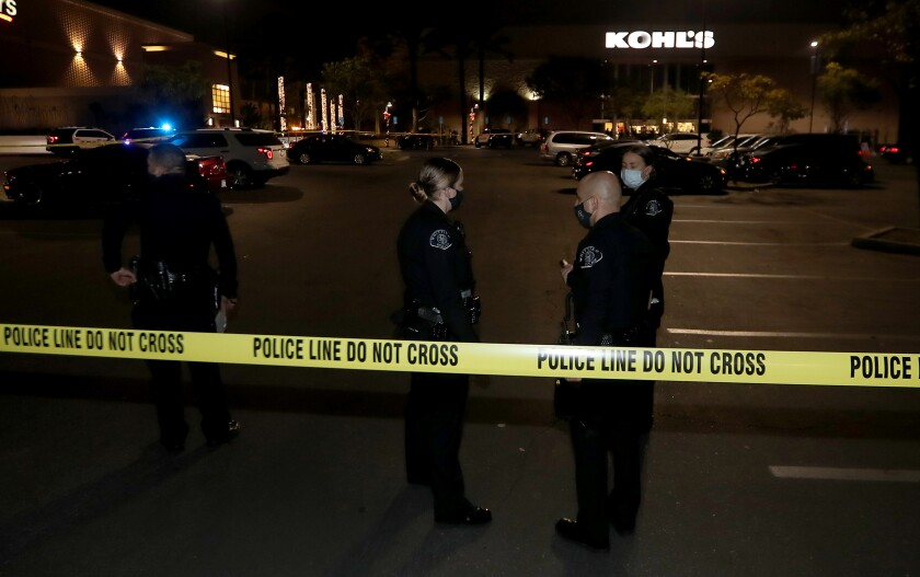 Police officers outside a Kohl's department store in Whittier