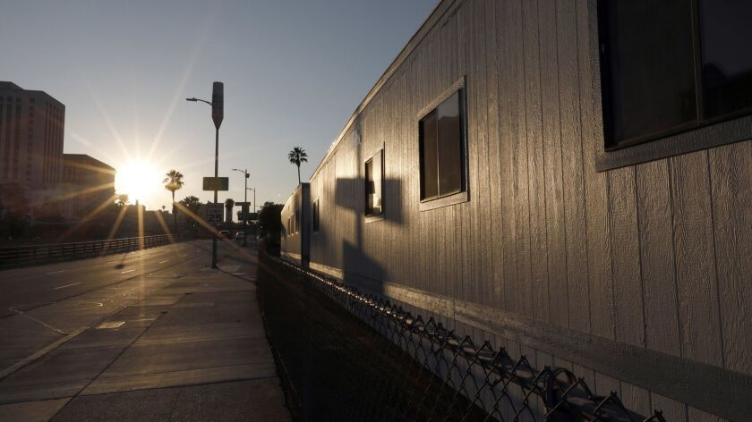 The trailers that form an emergency homeless shelter near the corner of Arcadia and Alameda streets in downtown L.A. The site will serve as a model for similar shelters throughout the city.