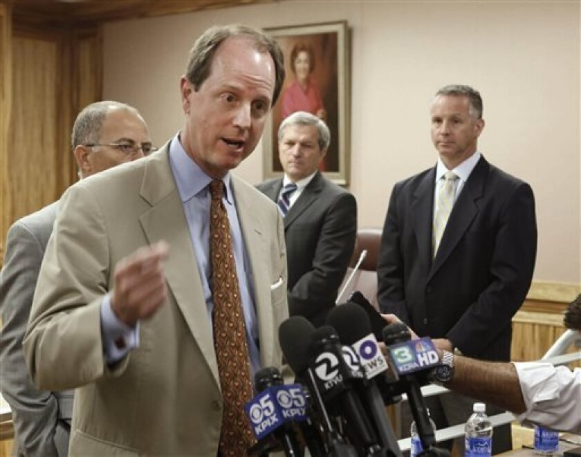 Steve Heminger, executive director of the the Bay Area Toll Authority and chairman of the Toll Bridge Program Oversight Committee, left, discusses the delay of the opening of the eastern span of the San Francisco-Oakland Bay Bridge, following a meeting with lawmakers in Sacramento, Calif., Monday, July 8, 2013. The new opening date for the $6.4 billion crossing, which had been set for Labor Day, will be delayed until after the retrofitting of failed seismic bolts is completed in December. In th
