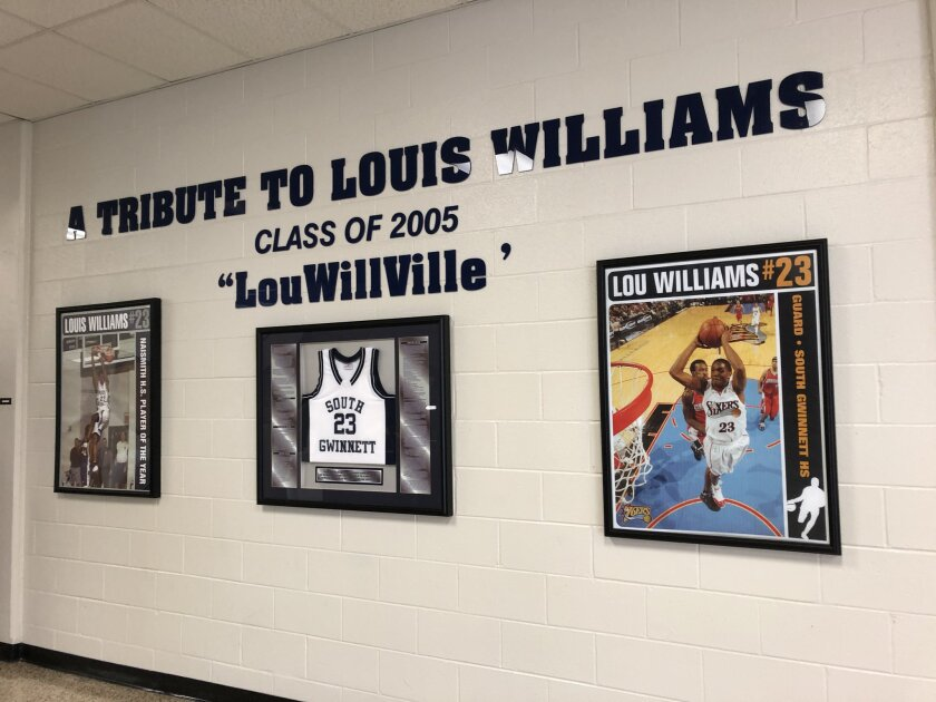 A wall inside the gym lobby at South Gwinnett High in Snellville, Ga., features a tribute to Clippers guard Lou Williams, Class of 2005.