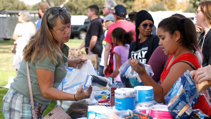 Donna Garland, 54, gathered food and toiletries at a event staged by a group of activists who gathered to feed the homeless at Wells Park in El Cajon, in defiance of a city ordinance that bans serving food on city property because of the hepatitis A outbreak.