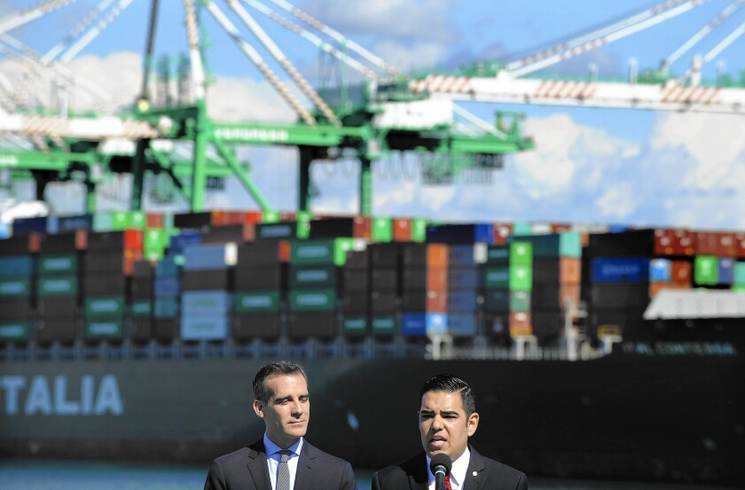 L.A. Mayor Eric Garcetti, left, and Long Beach Mayor Robert Garcia appear at a news conference Monday in San Pedro to celebrate the tentative deal between shipping companies and a union representing port workers.