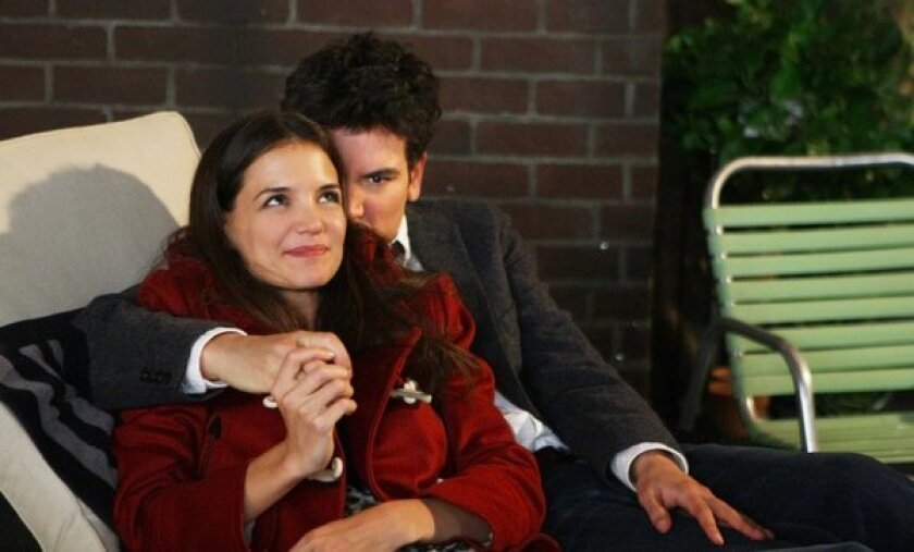 """A scene from the CBS series """"How I Met Your Mother"""" with Ted (Josh Radnor) and Naomi (Katie Holmes). Illegal copies of the TV show were distributed through the website mediamp4.com."""