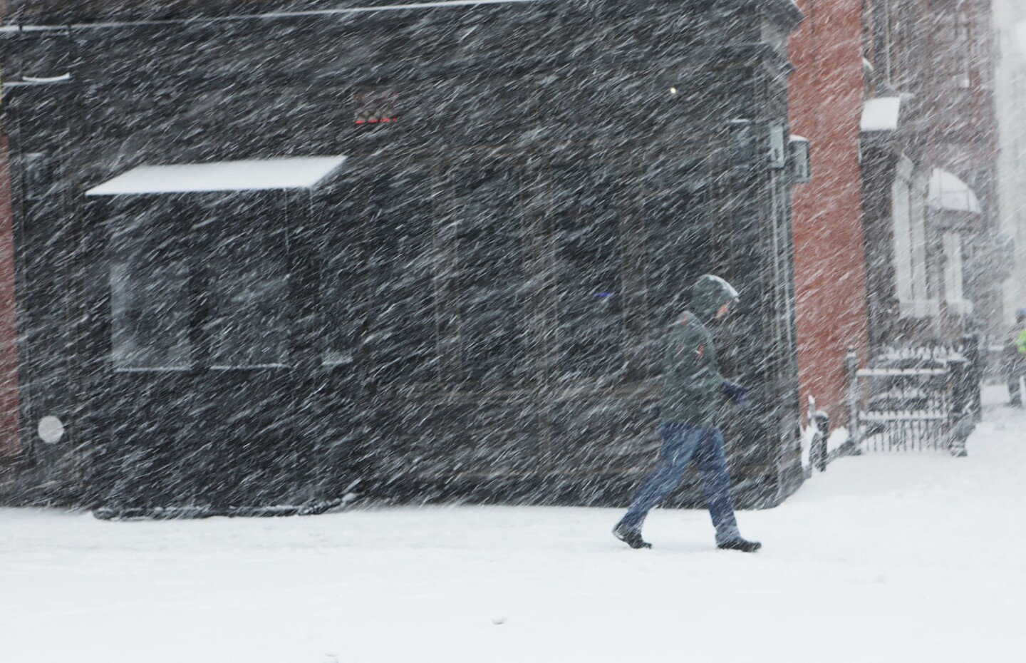 A pedestrian makes his way through the snow and wind in the Brooklyn borough of New York City.