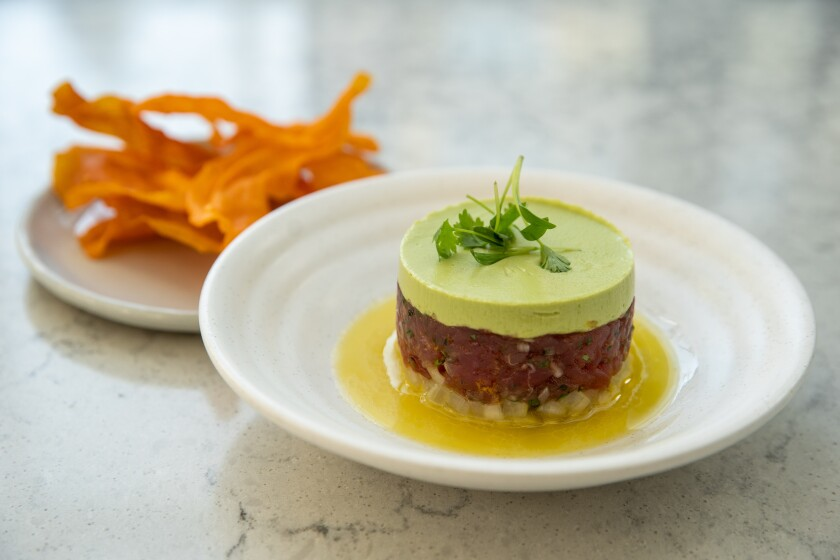 Ahi tuna tartare with avocado and cucumber yuzu served with sweet potato chips at Openaire