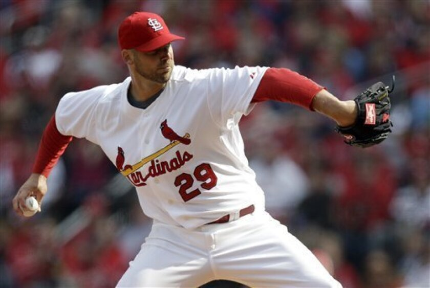 St. Louis Cardinals starting pitcher Chris Carpenter throws during the second inning of a baseball game against the San Diego Padres Thursday, March 31, 2011, in St. Louis. (AP Photo/Jeff Roberson)