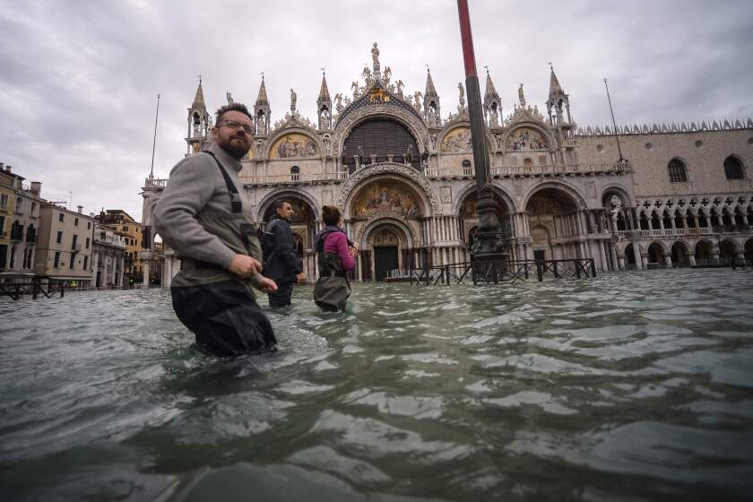 A general view shows people walking across the flooded St. Mark's Square, by St. Mark's Basilica on November 15, 2019 in Venice, two days after the city suffered its highest tide in 50 years. - Flood-hit Venice was bracing for another exceptional high tide on November 15, as Italy declared a state of emergency for the UNESCO city where perilous deluges have caused millions of euros worth of damage. (Photo by Filippo MONTEFORTE / AFP) (Photo by FILIPPO MONTEFORTE/AFP via Getty Images) ** OUTS - ELSENT, FPG, CM - OUTS * NM, PH, VA if sourced by CT, LA or MoD **