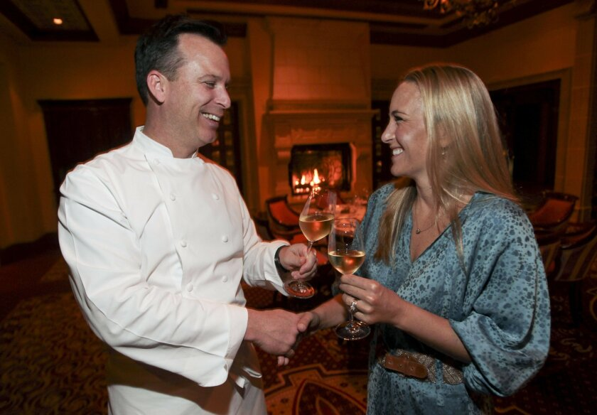 Lara Sailer Long, who is the US Ambassador for Krug, meets Chef William Bradley during the Krug Champagne Dinner at the Addison at the Grand Del Mar in San Diego on Thursday.