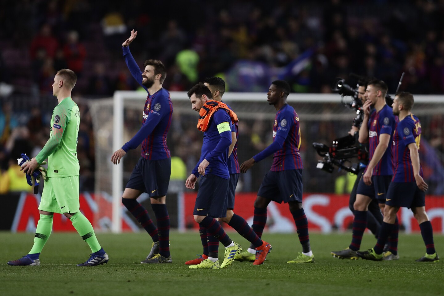 Barcelona defender Gerard Pique, second left, applauds fans at the end of the Champions League round of 16, 2nd leg, soccer match between FC Barcelona and Olympique Lyon at the Camp Nou stadium in Barcelona, Spain, Wednesday, March 13, 2019. (AP Photo/Manu Fernandez)