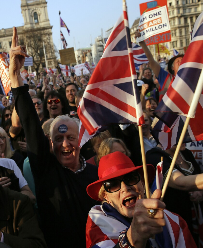 """Pro-Brexit leave the European Union supporters attend a rally in Parliament Square after the final leg of the """"March to Leave"""" in London, Friday, March 29, 2019."""