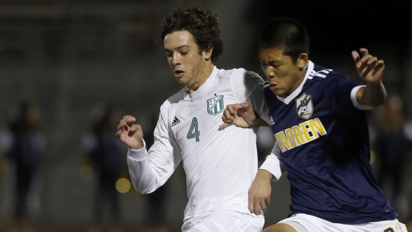 Edison High's Chase Bullock (4) battles Warren's Jasen Nicoles, right, for the ball during the first