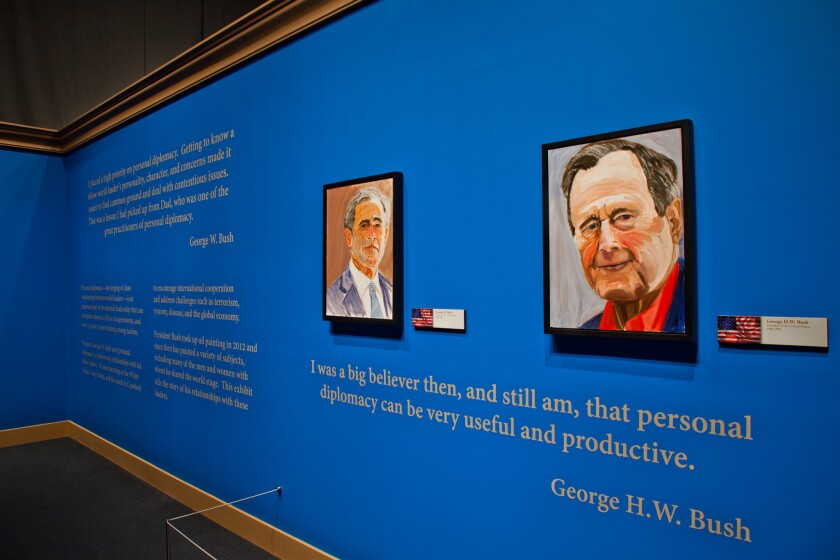 """George W. Bush's self-portrait, left, and a painting of his father are in """"The Art of Leadership: A President's Personal Diplomacy"""" at the George W. Bush Presidential Library and Museum in Dallas."""