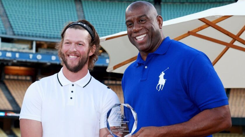 Dodgers pitcher Clayton Kershaw, left, and Magic Johnson at Kershaw's 5th Annual Ping Pong 4 Purpose Celebrity Tournament at Dodger Stadium on Thursday.
