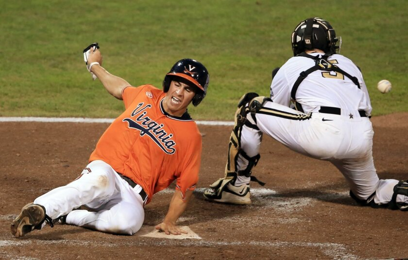 FILE - In this June 24, 2015, file photo, Virginia's Adam Haseley scores on a Pavin Smith single as Vanderbilt catcher Jason Delay waits for the throw during the fifth inning of Game 3 of the best-of-three NCAA baseball College World Series finals at TD Ameritrade Park in Omaha, Neb. The Atlantic C
